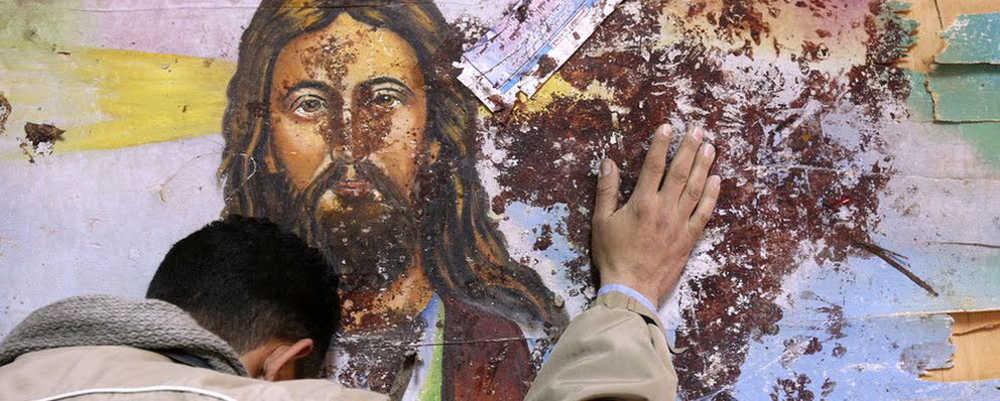 Cristo murales macchiato di sangue